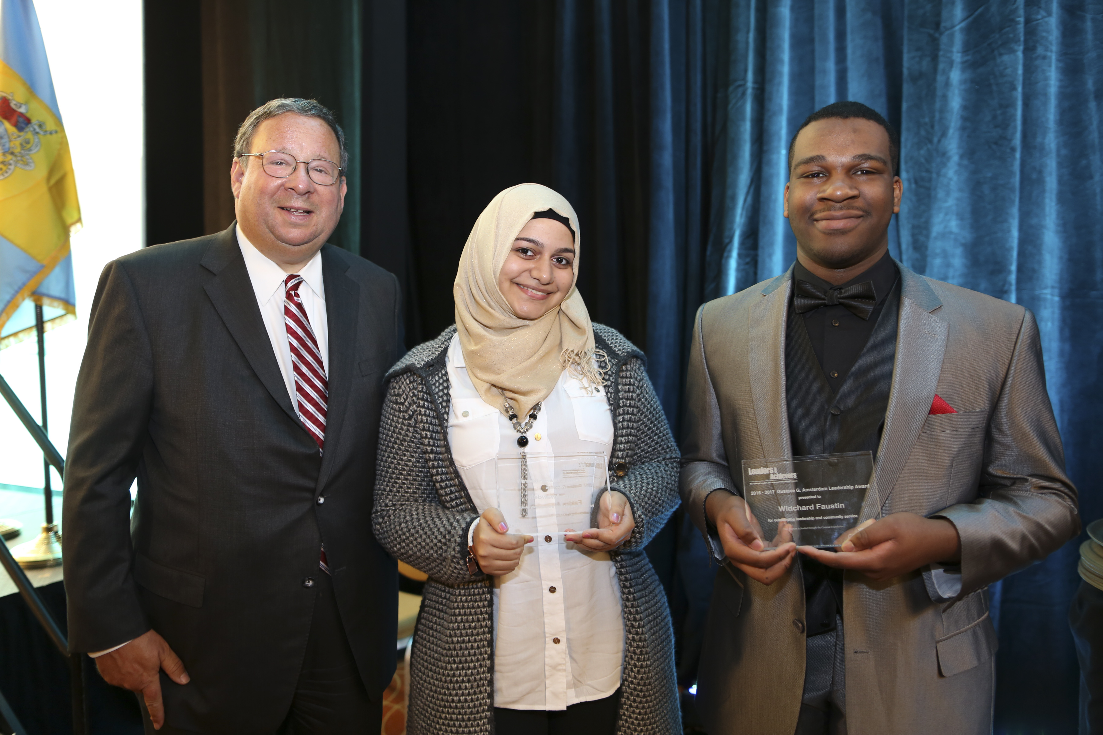 David L. Cohen, Senior Executive Vice President & Chief Diversity Officer poses with the Gustave G. Amsterdam Leadership Award recipients Fakira Awawdeh and Widchard Faustin on Thursday Feb. 2, 2017, during the Chamber of Commerce for Greater Philadelphia's Annual Mayor's Luncheon in Philadelphia.  (Comcast Photo/ Joseph Kaczmarek)
