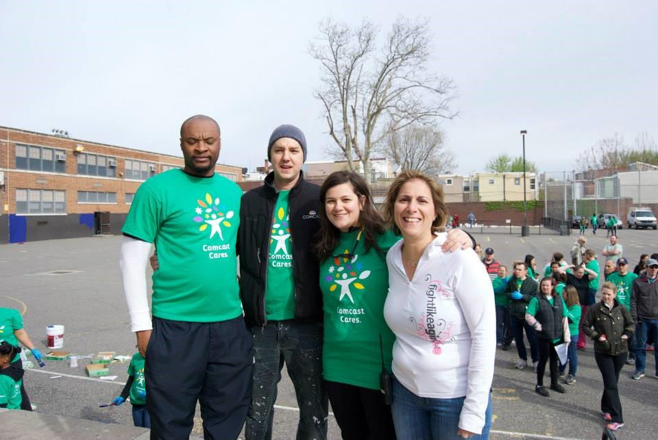 Comcast's three leads for Adaire's Comcast Cares Day project (l to r) from left, Chris Powell, Ryan Olah and Ali Porreca -- pose with Adaire Principal Anna Jenkins, right