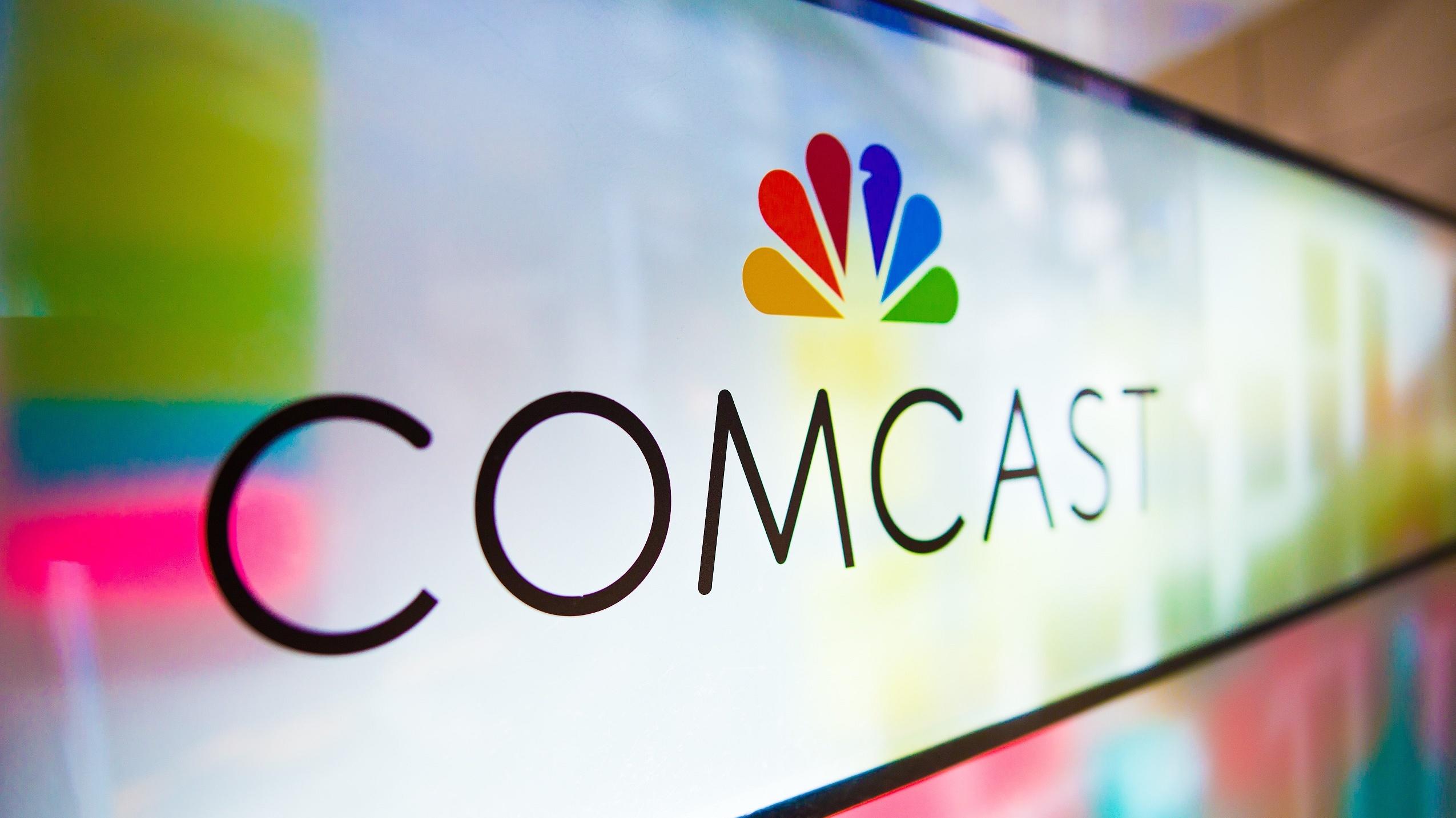 Comcast logo on a glass wall