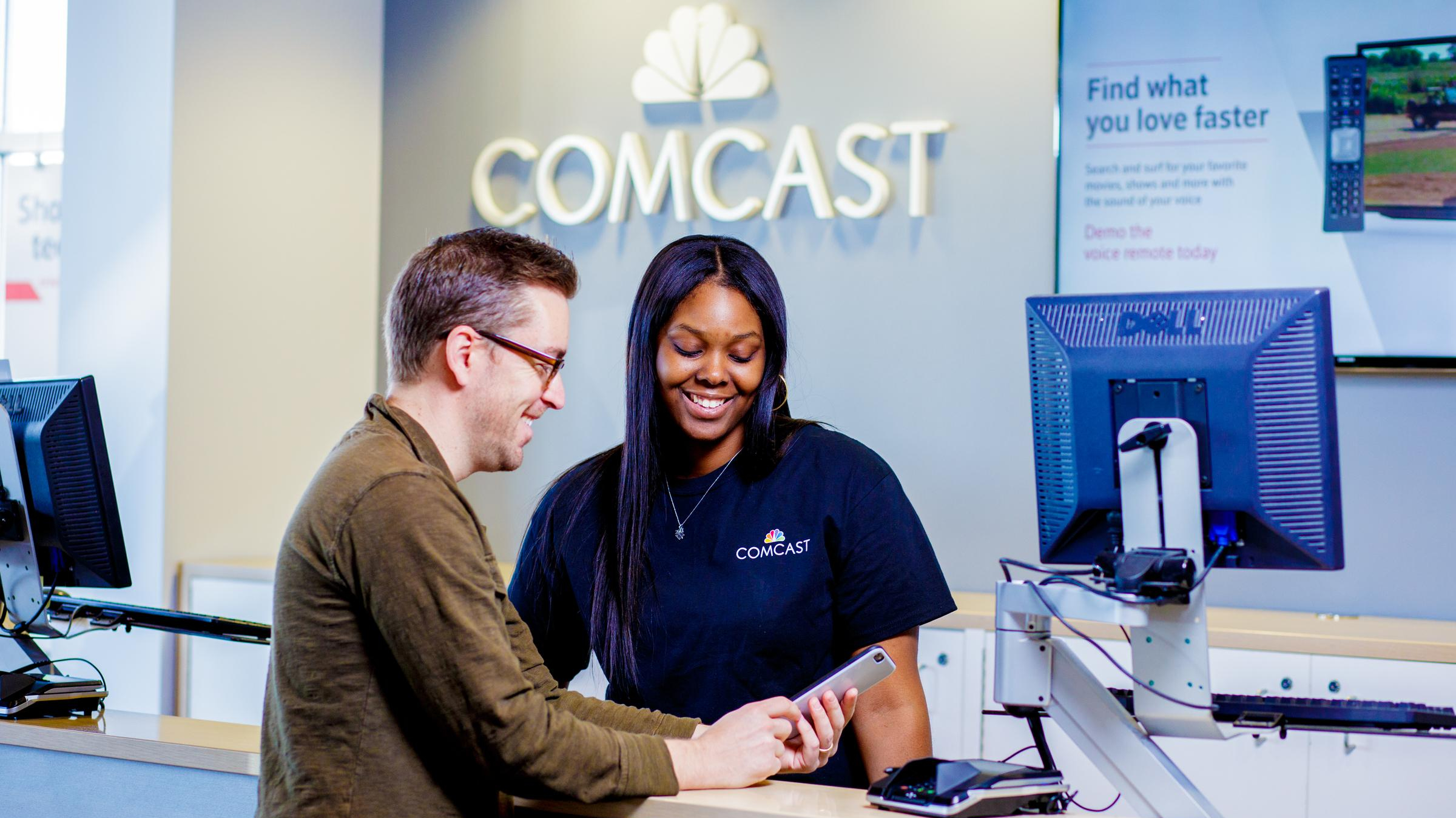 An Xfinity Store team member assists a customer