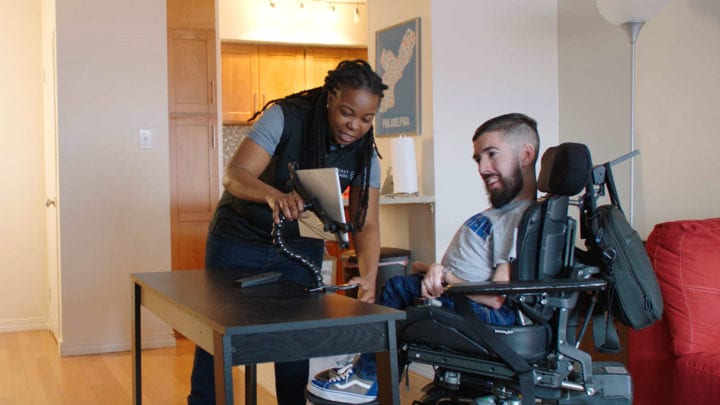 Man in a wheelchair using eye control technology